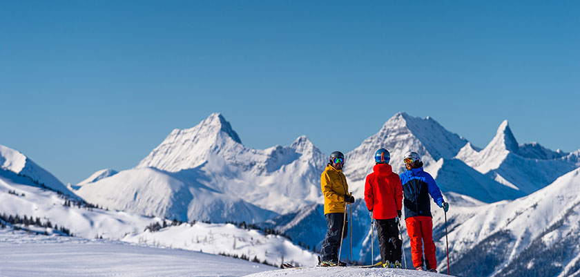 skiers-in-front-of-the-mountains.jpg